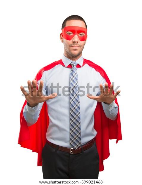 Confident super businessman with keep calm gesture