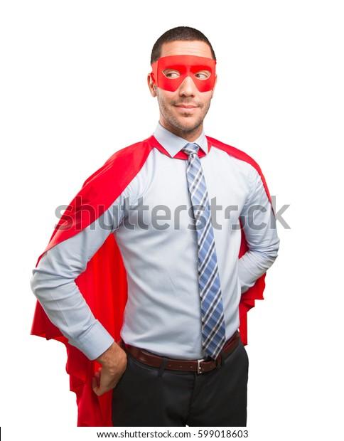 Confident super businessman looking