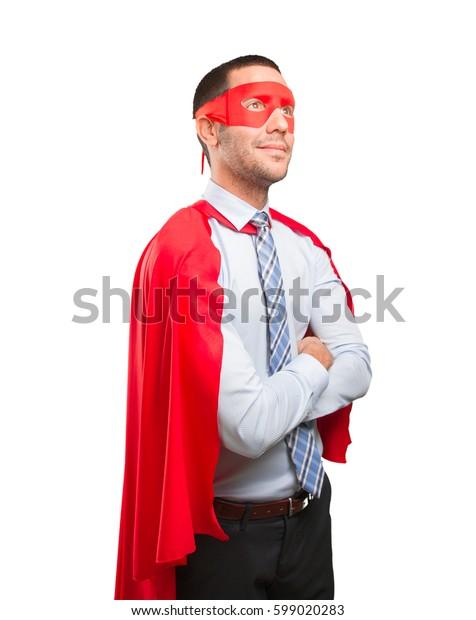 Confident super businessman looking up