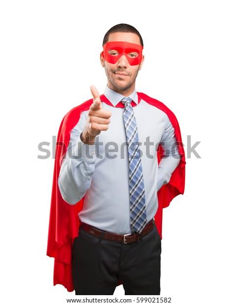 Confident super businessman pointing