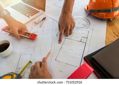 Confident team of architect working together in a office.Then discussing about new startup project on desk. Architect discuss with engineer about project in office, architectural concept