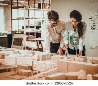 Confident team of engineers working together in a architect studio