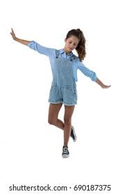 Confident teenage girl posing on white background