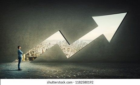 Confident thinking businessman with crossed hands meditate alone in front of a rising graph arrow shaped as a hole in concrete wall with a view to the cityscape. Financial success concept.