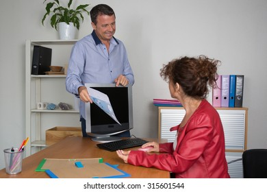Confident woman and man at work in a bright and modern office building