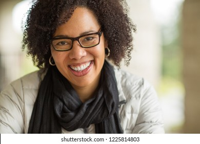 Confident woman smiling.