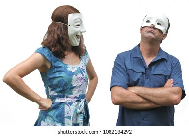 Confident woman wearing a happy face mask looks at at unconfident man who wearing a sad face mask. Real people. Copy space