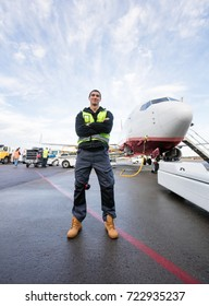 Confident Worker Standing Arms Crossed On Wet Runway