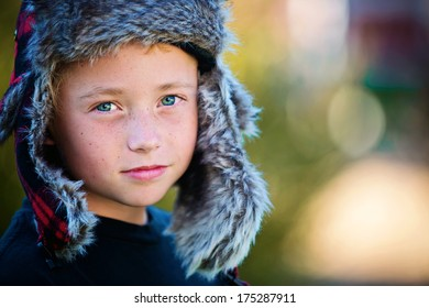 Confident young boy in winter hat