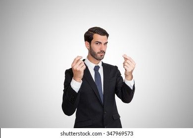 Confident young business man asking money by hand gesture.