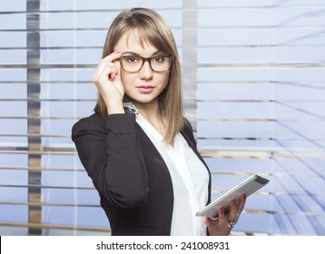 Confident young business woman in the office