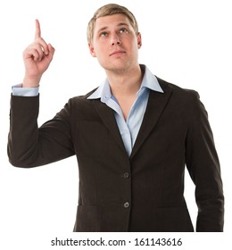 A confident young businessman pointing upwards while isolated on a white background