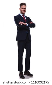 confident young businessman standing on white background with hands crossed, full body picture