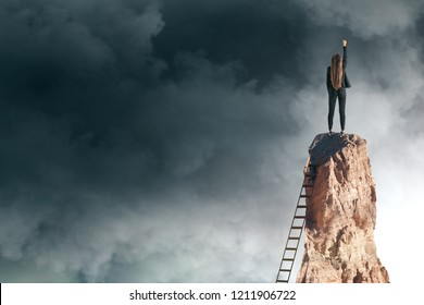 Confident young businesswoman with raised arm standing on sky background. Success and risk concept