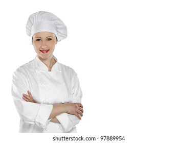 Confident young female chef with arms crossed  isolated on white