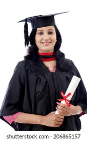 Confident young female student holding diploma
