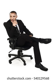 Confident young handsome businessman sitting on an executive chair isolated on white background