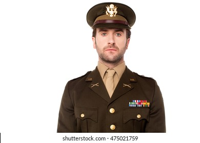 Confident young isolated army man in uniform