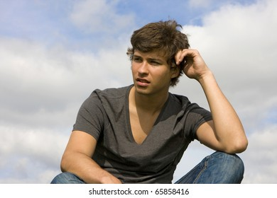 Confident young man looking away