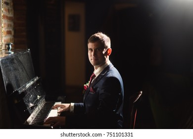 Confident young man is playing piano