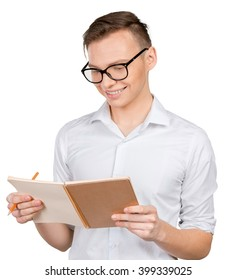 confident young man in shirt making notes in his pad