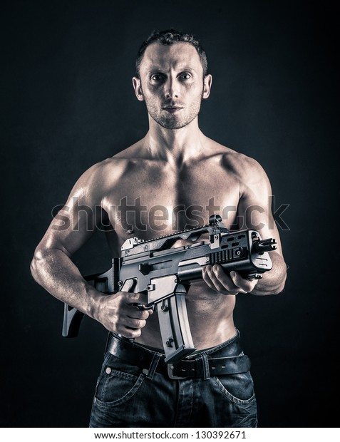 Soldier Standing With Gun In His Shoulder Stock Photos