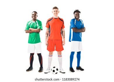 confident young multiethnic soccer players standing together and smiling at camera isolated on white