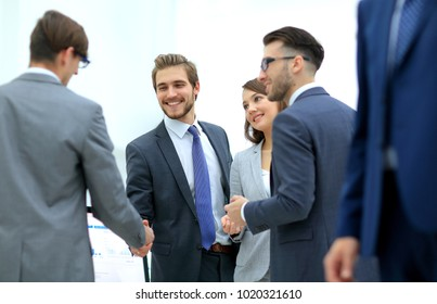 Confident young people, handshake and smile