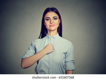 Confident young woman isolated on gray wall background
