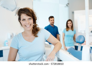 Confident young woman smiling happy at dentist's surgery.