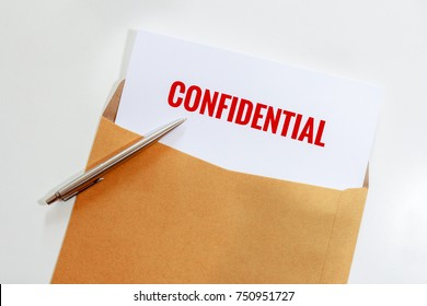 Confidential document in envelope with pen on desk