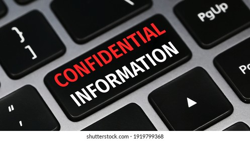 Confidential information text on a keyboard. Technology and business concept.