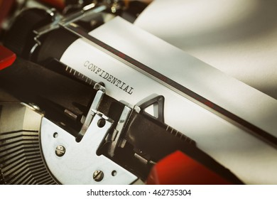 Confidential memo typed on a typewriter and a white page, closeup.