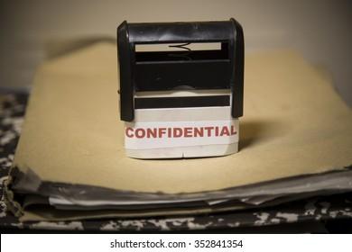 Confidential stamp sining big paper folder of top secret documents