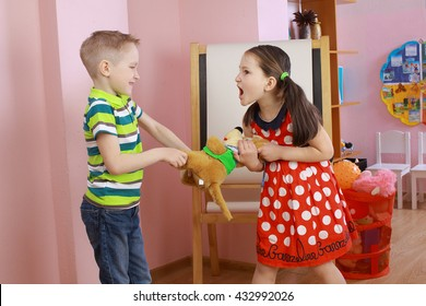the conflict between a boy and a girl. the kids are fighting, the boy takes the girls toy.