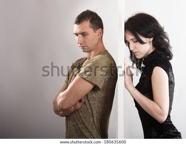 Conflict between man and woman concept. On opposite sides of the door.