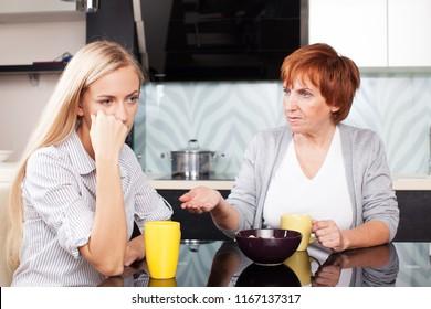 Conflict between mother and daughter. Quarrel