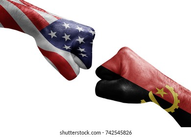 conflict between USA vs Angola, male fists - governments conflict concept,  Flags written on hands USA, USA Flag, USA  counter, fists symbol war