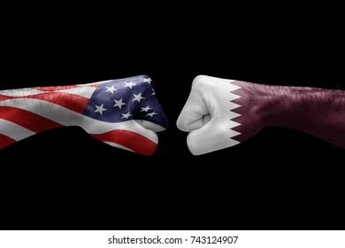 conflict between USA vs Qatar, male fists - governments conflict concept,  Flags written on hands USA, USA Flag, USA  counter, fists symbol war
