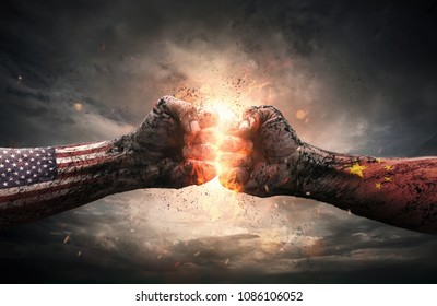 Conflict, close up of two fists hitting each other over dramatic sky background with copy space