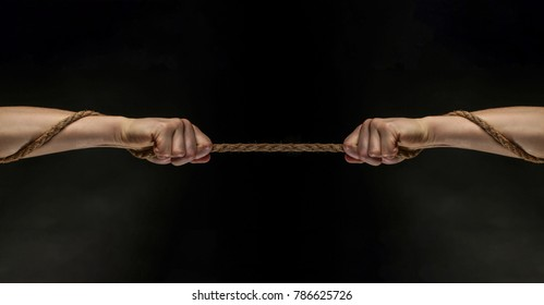 Conflict, tug-of-war, rope. Hand holding a rope, climbing rope, strength and determination concept. Safety. Macro shot isolated over black background.