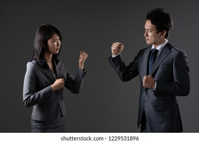 Conflicting businessman and business woman