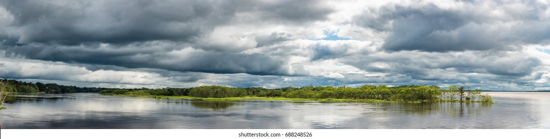 Confluence of the Amazon river and the Rio Maranon and Rio Ucayali as a stom approaches