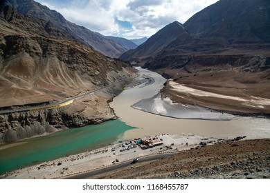 Confluence of the Indus and Zanskar Rivers are two different colors of water ,Zanskar river is shiny blue in colour, Indus river looks a little green in Leh, Ladakh, India