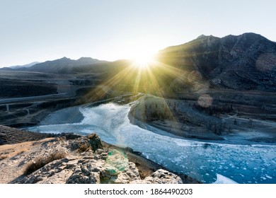 The confluence of Katun river and Chuya river along Altai mountains , Russia .sunrise, sunset,