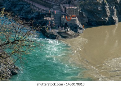Confluence of muddy colored Alakananda and green colored Bhagirathi river to form Ganges at Devprayag, Uttarakhand, India. This point is known as Sangam & people offers prayers at temple built here.