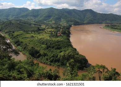 The Confluence of the River Mekong, and the Smaller River Hueang near Chiang Khan. West of this Point, the Hueang Forms the Thai-Laos Border. East of this Point, The Mekong Forms the Thai-Laos Border.