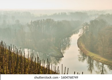 Confluence of rivers Elbe -Labe - and Vltava in mist in town Melnik, Czech republic