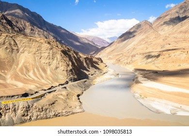 Confluence of Sindhu (Indus) and Zanskar Rivers; these two lines are different shades of color in summer Himalayas, Ladakh, India.