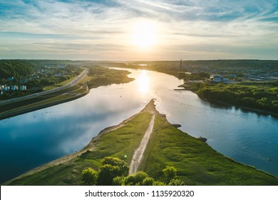 Confluence of two rivers (Namunas and Neris) in Kaunas old town, Lithuania. Drone aerial view.